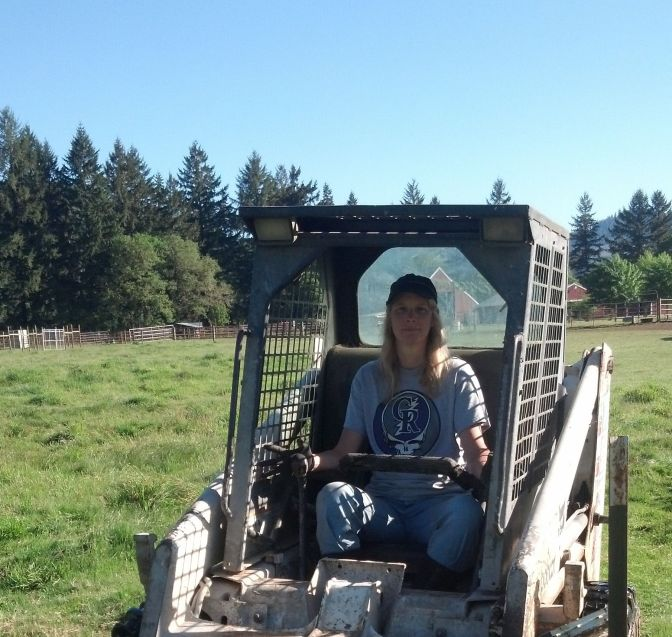 That's me, your fearless blogger, at the control of the Bobcat.  Be afraid.  Be very afraid.