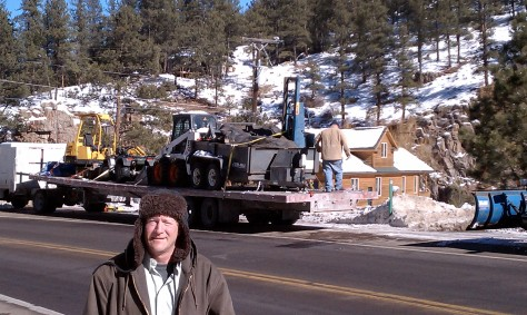 Bob on Feb. 11th, 2011. standing in front of the semi truck loaded with his heave equipment.