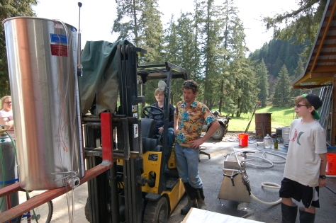 Nathan helps Iain raise the variable container holding the filtered wine so gravity can be used to fill the bottles.