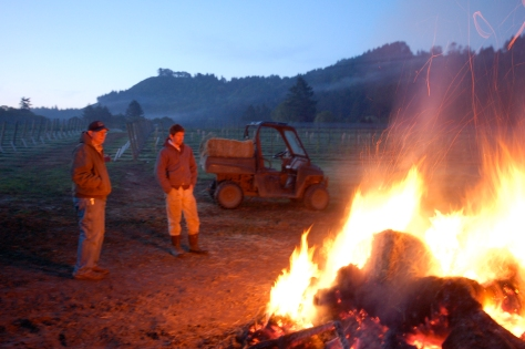 Nathan and Bob warming themselves at daybreak.  Notice the bale of hay in the buggy.  We started tossing hay on the fire when we were running out of stumps to burn.