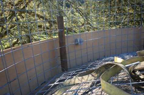 The top of the silo before the pour, prepared with hog wire to hold the concrete.