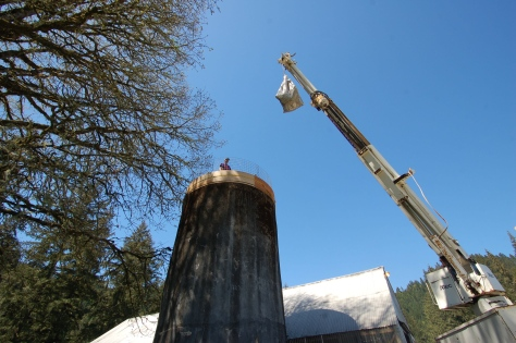 The first load of concrete heading for the top of the silo next to the barn that Bob is converting into an Observation Tower.
