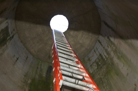 The Way Up; an extension ladder inside the silo.