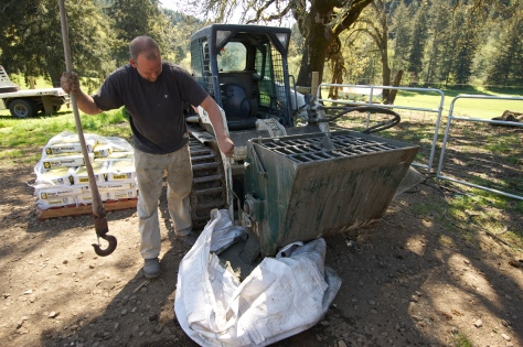 When the concrete was ready, Nick loaded it into a huge, sturdy sack made of tarp material.